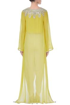 Yellow top & cream pants.