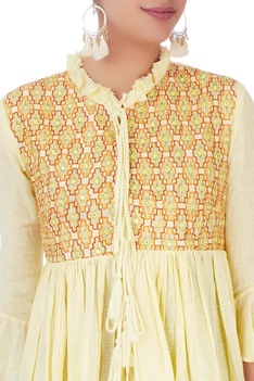 Yellow pleated blouse with flared sleeves