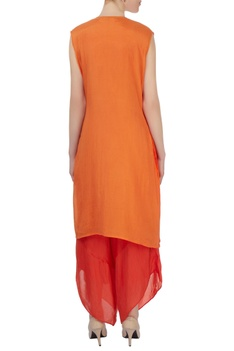Coral red jumpsuit with orange jacket