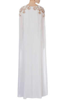 White flowy cape style gown