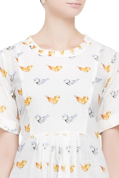 White blouse in multicolored bird motifs
