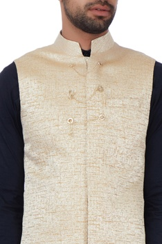 Beige textured jacket with chain buttons