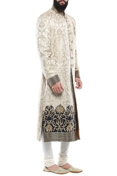 Gold brocade hand embroidered sherwani with churidar