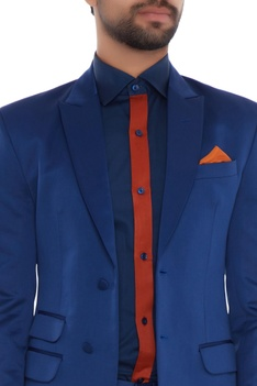 Royal blue jacket with blue shirt, trousers & rust pocket square