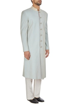 Powder blue spun silk sherwani with embroidered buttons & pants