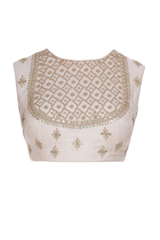 Embroidered sleeveless blouse with lace border saree.