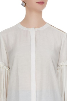 Off-white blouse with ruffle detail sleeves