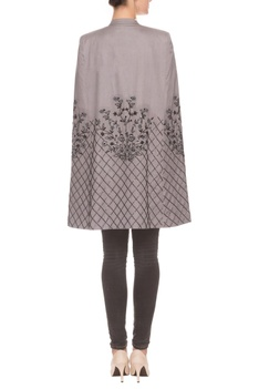 Grey cut out tunic with embroidered details