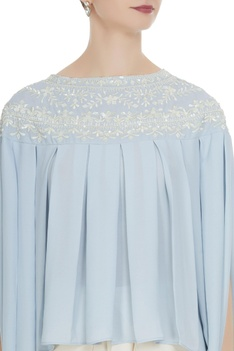 Light blue georgette pearl embroidered pleated blouse with cream crepe dhoti pants