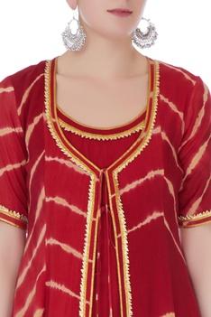 Deep red mullmull gotta patti anarkali with jacket has a round neckline