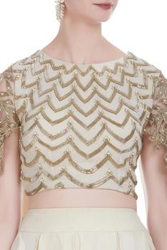 Leaf cutwork blouse with box pleated lehenga