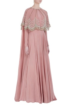 Floor length gown with embroidered cape
