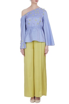 One-shoulder sequin blouse with flared pants