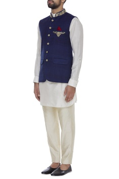 Raw silk jacket with embroidered pockets