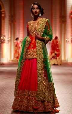Orange embroidered kurta with pink lehenga & green dupatta