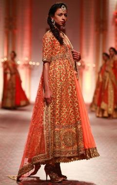 orange anarkali set with gold embroidered jacket
