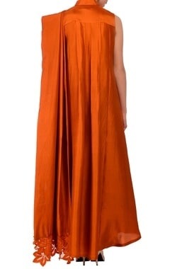 Burnt orange draped tunic with cream palazzos