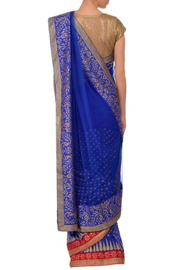 Blue embroidered sari with brocade blouse