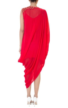 Red one shoulder draped dress