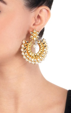 Gold polished pearl & kundan enhanced earrings