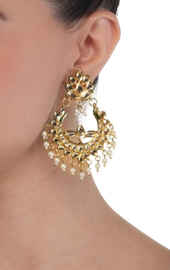 Gold polished earrings with pearl embellishments
