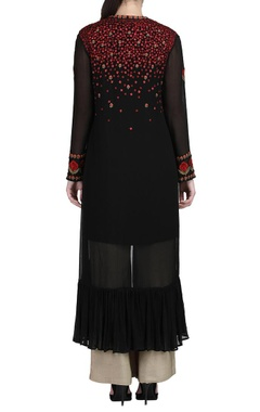 Black embroidered jacket with slip & beige trousers