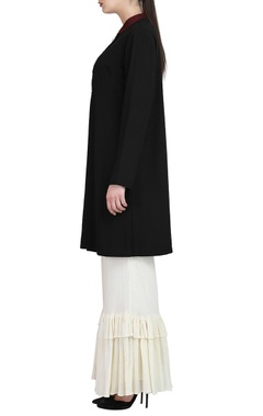 black embroidered tunic & ivory ruffle pants