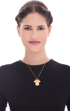 gold necklace with hamsa pendant