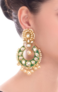 gold finish kundan earrings with green accent