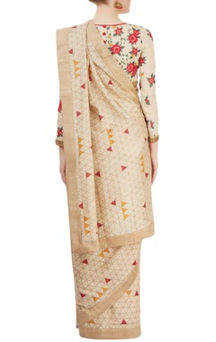 beige printed sari with embroidered blouse