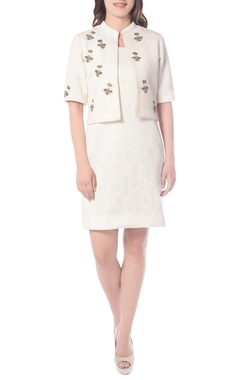 white embroidered dress with a jacket