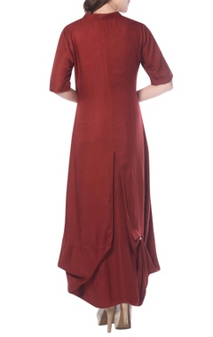 crimson draped tunic