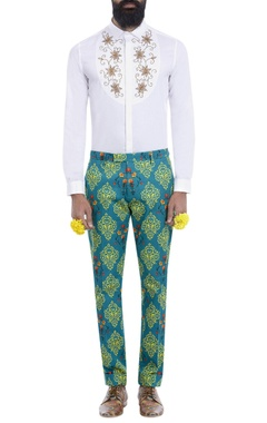 Teal blue motif print trousers