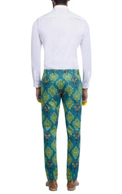 teal blue motif print trousers