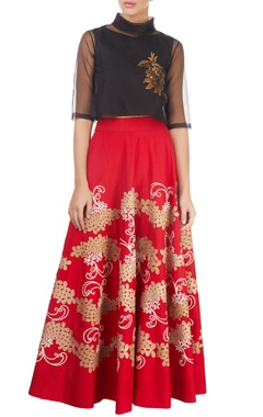 red skirt with gold tissue applique