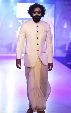 Arjun Khanna White lungi with gold border