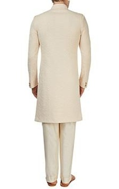 Cream embossed sherwani