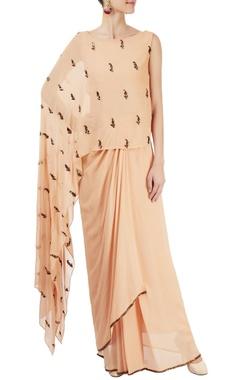 peach sari with one side cape