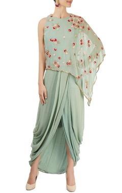 green draped dress with short cape