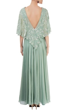 green pleated gown enhanced with zardozi
