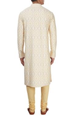 ivory cutwork kurta with beige churidar