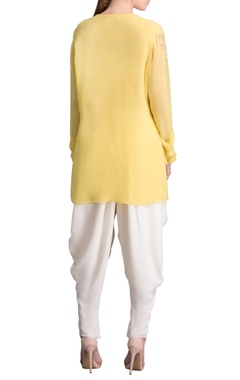 yellow sequined shirt with tree motifs