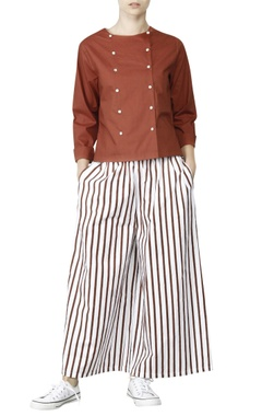 White palazzos with brick red stripes
