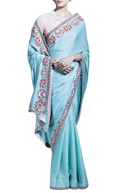 Light blue sari with striped light pink blouse