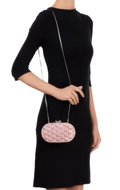 Pink clutch with cutwork detailing