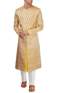 Beige brocade sherwani with white pants