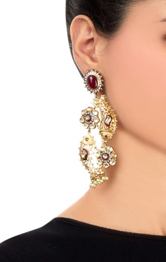 Gold earrings with fish motif