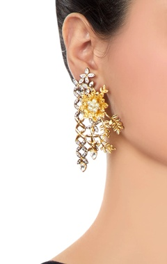 Gold earrings with floral motifs
