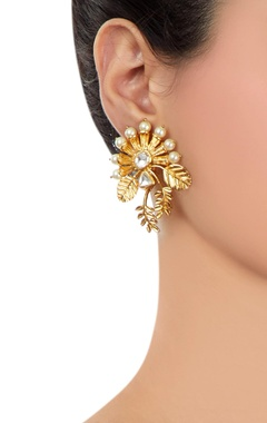Gold leaf motif earrings with kundan crystals
