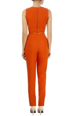 Orange jumpsuit with drape